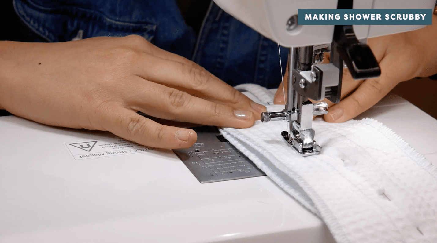 A picture containing text, sewing machine, person, appliance Description automatically generated